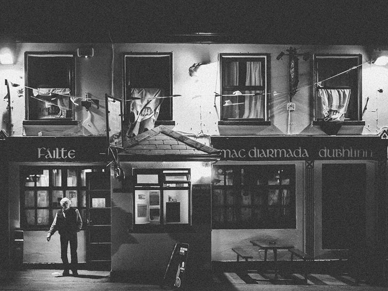 Irishman stepping out of a pub in Doolin