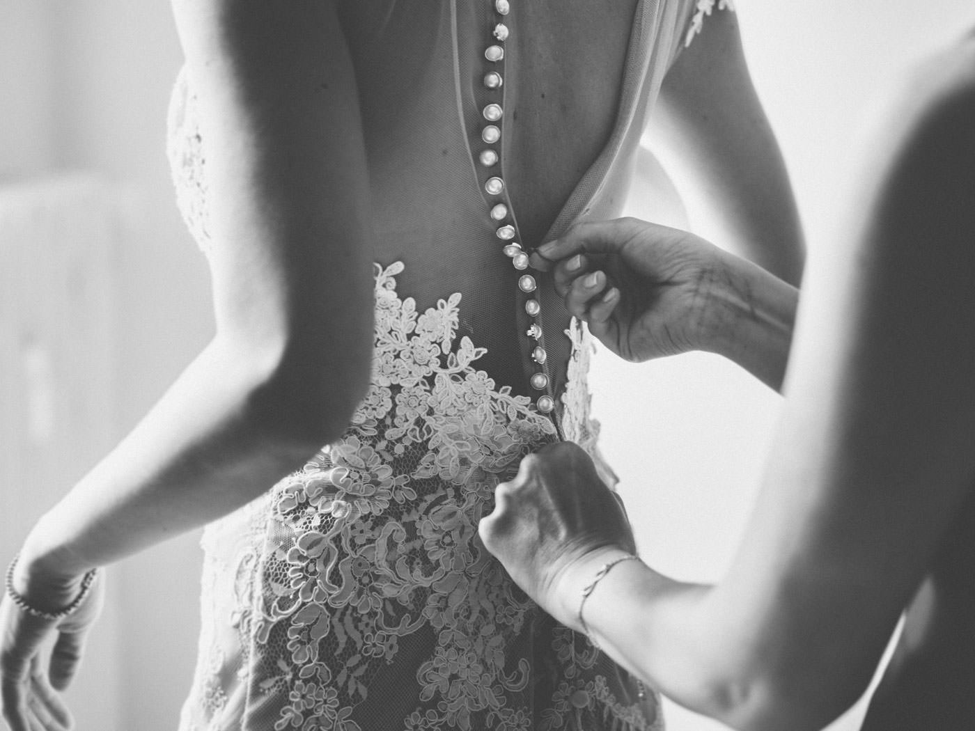 Bride getting into her Boho Vintage wedding dress