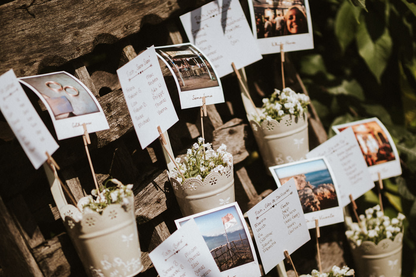 Seating plan thought differently - with Polaroids and Flowers